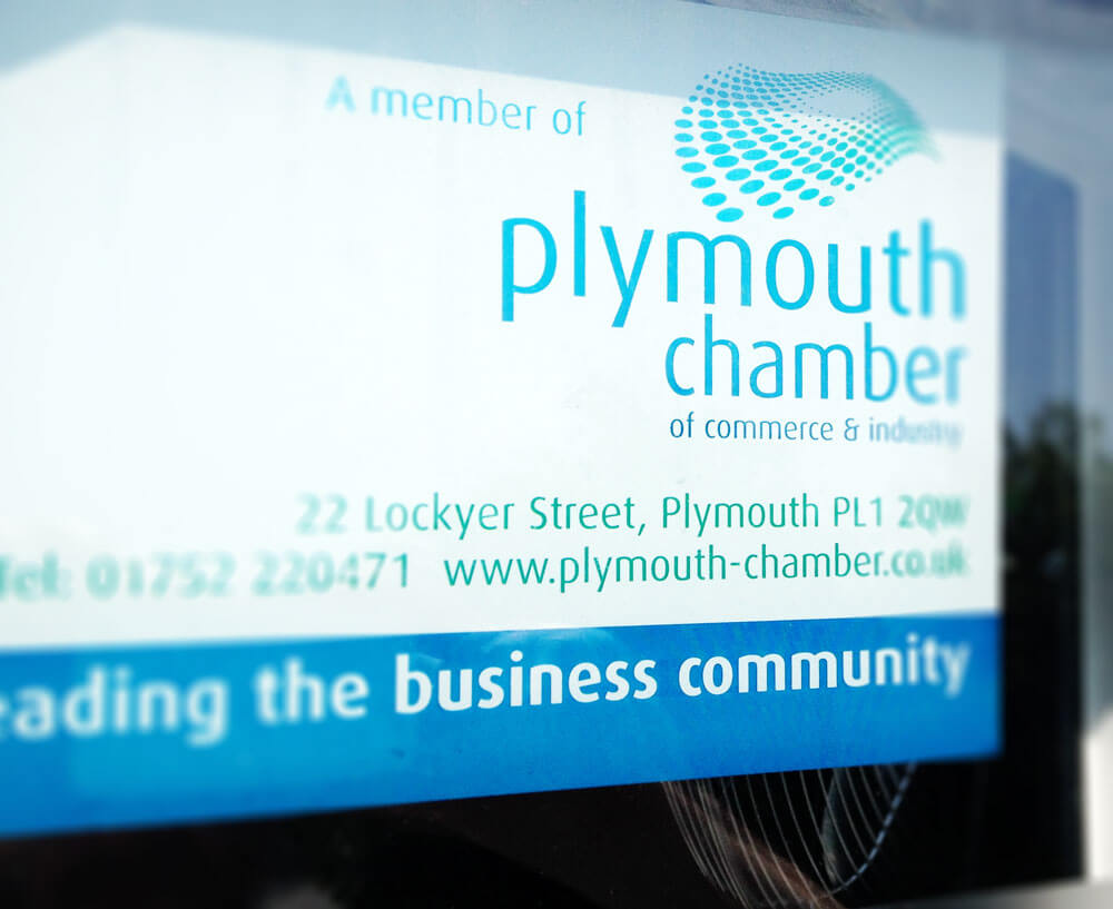 A picture of a clear window sticker produced for plymouth chamber of commerce